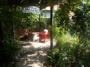 The back terrace, created just this past spring in the most private and secluded corner of the garden...